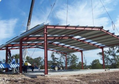 Structural beams supplied by ISM Manufacturing being erected for a shed