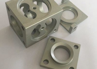 Precision machining used to manufacture a mechanism that is part of a locking feature on trains
